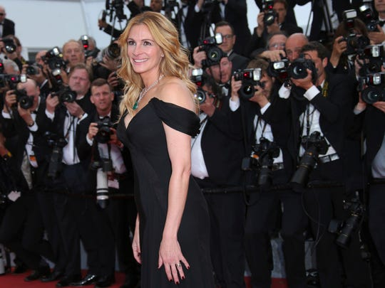 In this Thursday, May 12, 2016, file photo, Actress Julia Roberts poses for photographers upon arrival for the screening of the film Money Monster at the 69th international film festival, Cannes, southern France.