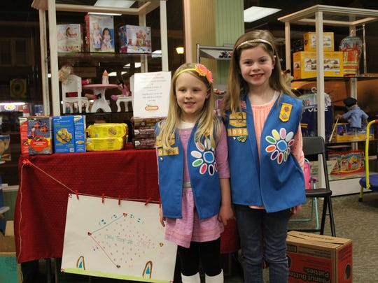 Alina Bolf (left) and Elizabeth Molino, both 6 and members of Daisy Troop 30987, were at the Toy Market on Jan. 19 selling Girl Scout cookies.