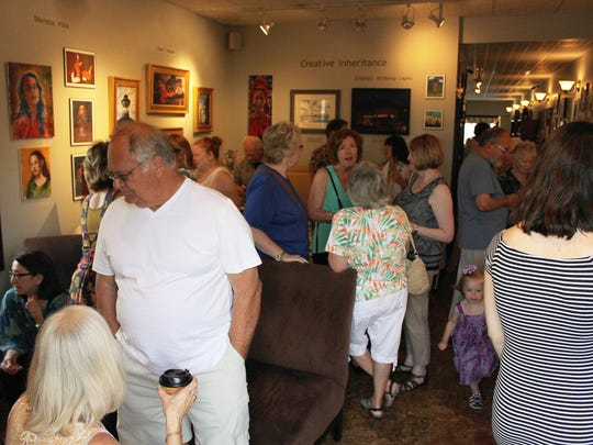 Casciano Coffee Bar and Sweetery was packed for the reception of the Natale Family Exhibit.