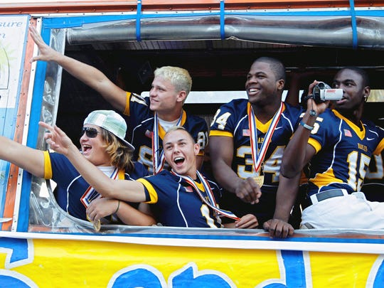 Naples football players from left, Tony Perez-Benitoa, Fred Wingate, Rob Randolph, Carlos Hyde and Juno Prudhomm, point and wave from the window of a trolley as it turns onto 8th Street in Naples during a parade for the Class 3A state champions on Dec. 20, 2007. Hundreds of Naples residents came to show their support to the Golden Eagle team that went 15-0 for the first time.