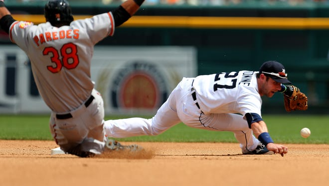 The Detroit Tigers' Andrew Romine cant get to the ball as the Baltimore Orioles' Jimmy Parades slides into second base during fourth inning action on Sunday, July 19, 2015 at Comerica Park in Detroit.