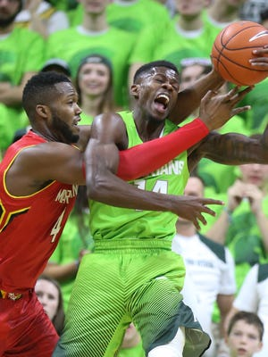 Michigan State's Eron Harris rebounds against Maryland's Robert Carter during the first half Saturday at the Breslin Center.