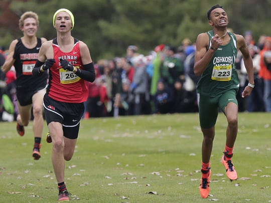 Oshkosh North's Wesley Schiek, right, pulls ahead of Neenah's Matt Meinke during the WIAA 2017 cross country state championship Boys division 1 race on Saturday, October 28, 2017, at Ridges Golf Course in Wisconsin Rapids, Wis.