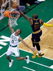Cavaliers forward LeBron James, right, blocks a shot by Celtics guard Avery Bradley during the first half of Game 2 of the Eastern Conference finals May 19, 2017 in Boston.