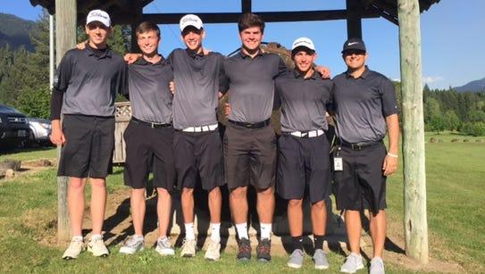 Current West Salem boys golf coach Travis Myers (far