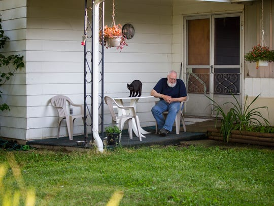 Smith sits on his Pike County front porch. He doesn't