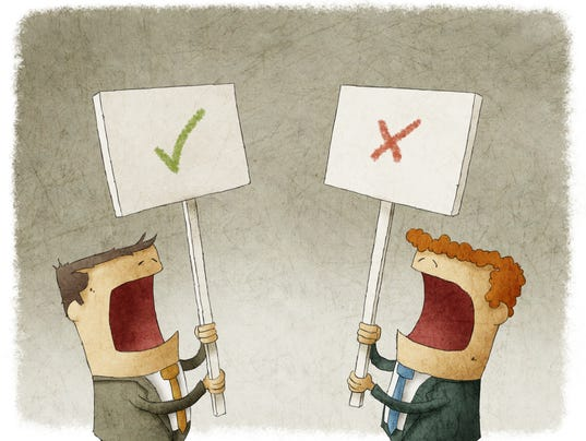 holding a sign protesting with different opinions