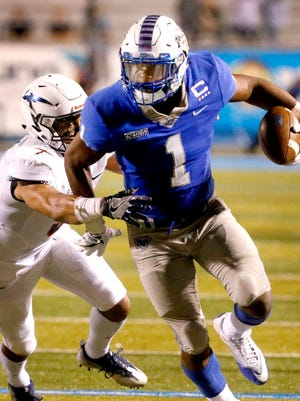 MTSU's Shane Tucker (1) runs the ball as UTEP's Nik Needham (5) moves in for the tackle during the game against UTEP, on Saturday, Nov. 4, 2017, at MTSU.