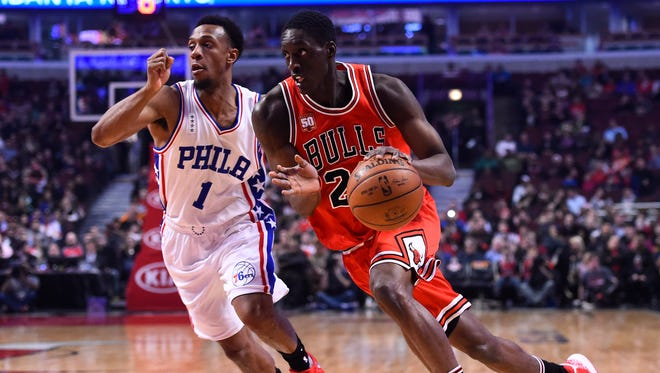 Chicago Bulls forward Tony Snell dribbles the ball past Philadelphia 76ers guard Ish Smith during the fist quarter of a game in April at the United Center.
