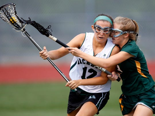 Archmere's Camryn Howarth (left) is closely defended by St. Mark's Megan Noonan as she tries to carry out of her defensive zone in the first half of St. Mark's 14-13 win in a state tournament semifinal Tuesday at Carvel Academy.