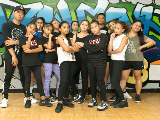From left, Noel Santos Jr., dance instructor is photographed along with students at Talent Box in Mangilao on March 23.