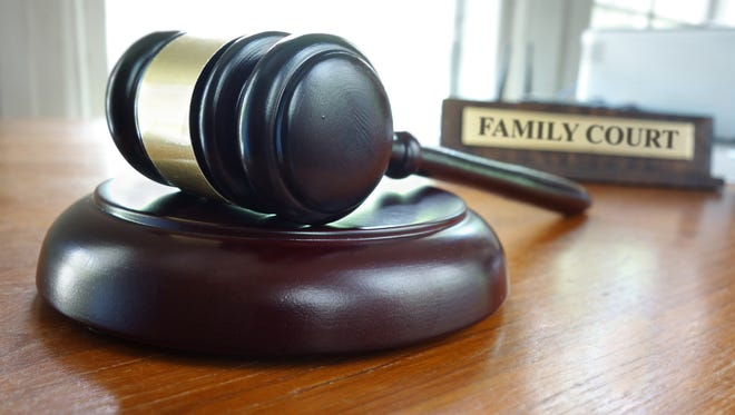Judge's gavel on a desk with Family Court nameplate.
