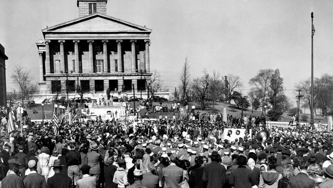 Hundreds of people gathered before Tennessee's Capitol and the War Memorial building as a Armistice Day parade ended in solemn memorial services at Memorial Square. (11/11/1948)