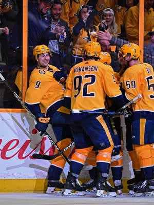 Predators left wing Filip Forsberg (9) celebrates with his teammates after his second goal during the third period in game 1 of the first round NHL Stanley Cup Playoffs at the Bridgestone Arena Thursday, April 12, 2018, in Nashville, Tenn.