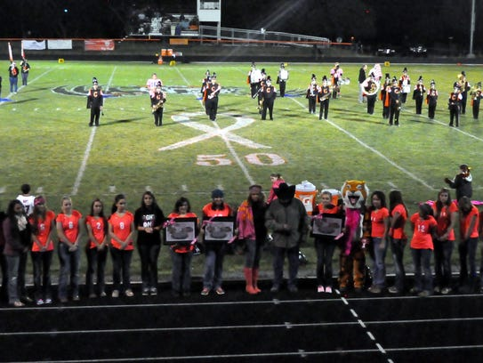 The Capitan Tigers honored local breast cancer survivors