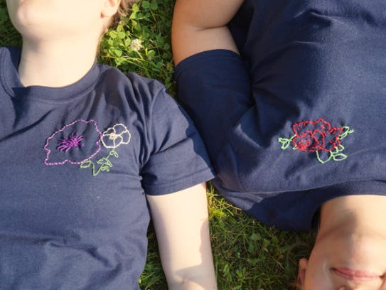 A photo features two of Laney Hughes' hand-embroidered