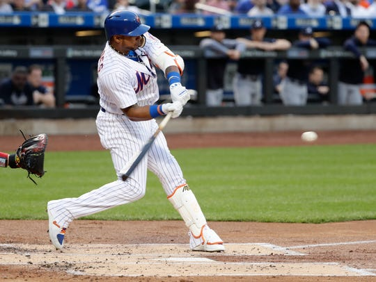New York Mets' Yoenis Cespedes hits a double during