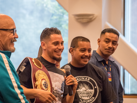 "Ruben Villa IV (second from left) speaks at the Monterey County Board of Supervisors July 24 as he was honored when the day was deemed ""Ruben Villa Day."" Villa also spent time before his latest fight organizing a food drive in Salinas."