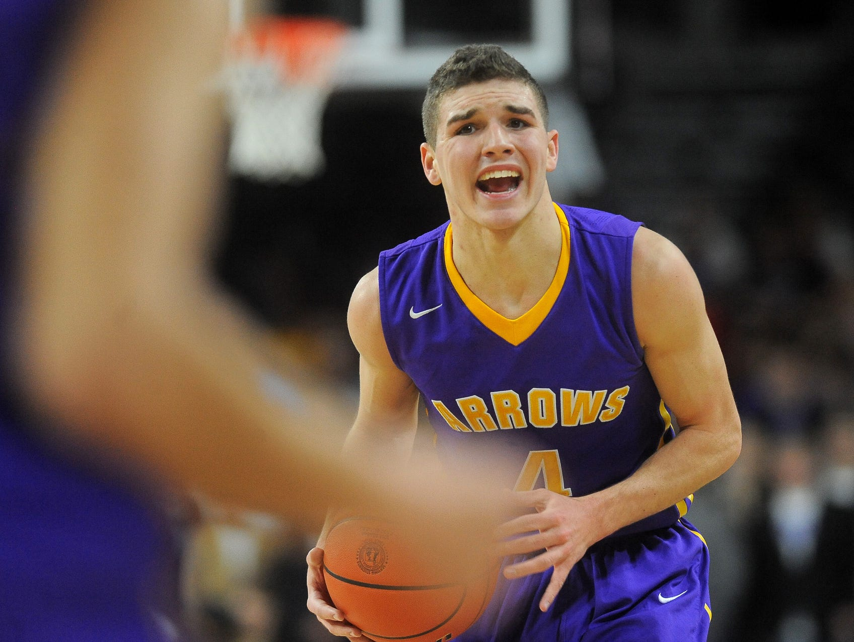 Watertown's Nate Davis shouts to a teammate while they play Lincoln at the Denny Sanford Premier Center on Thursday, March 19, 2015.