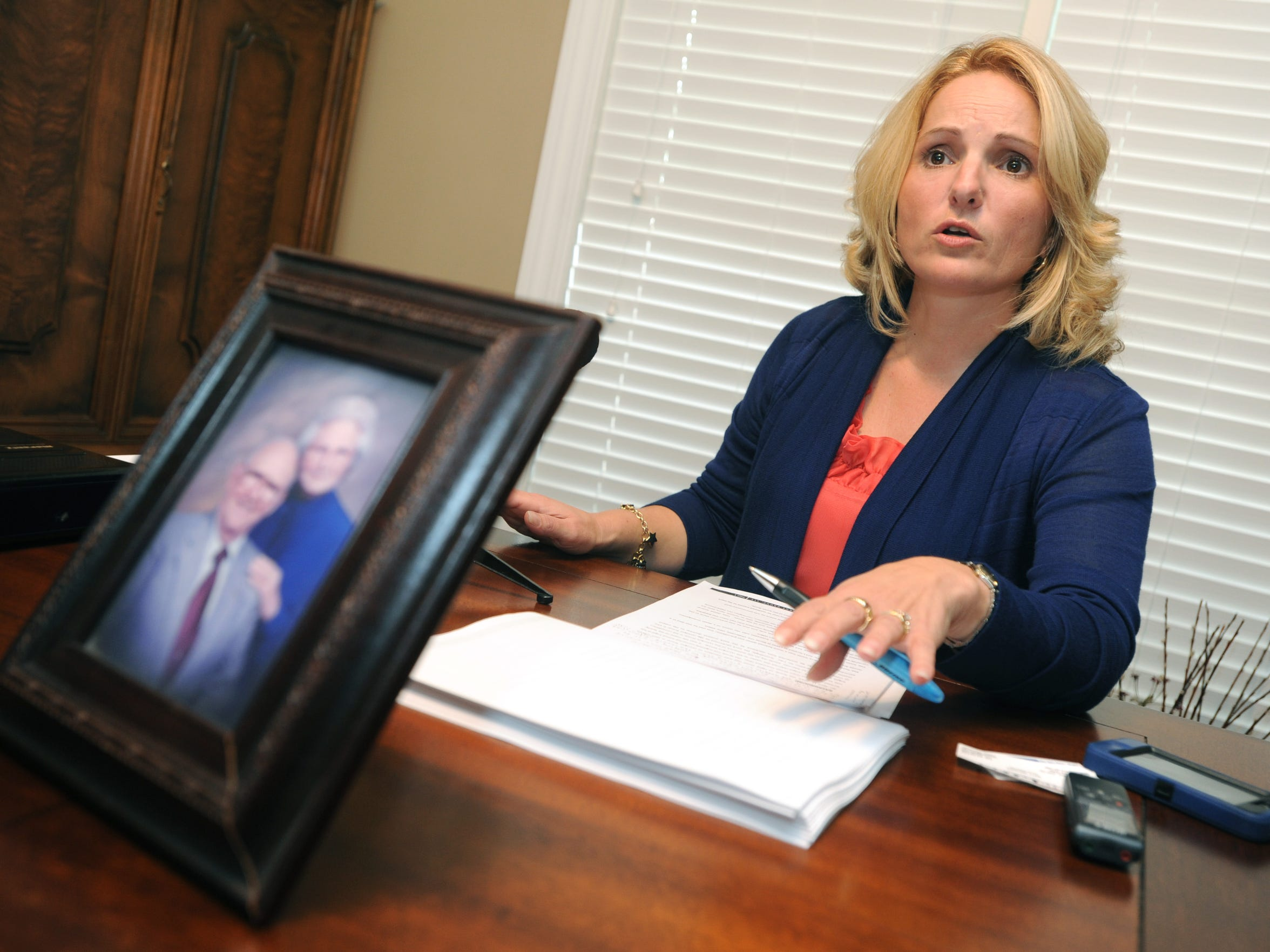 Smith family spokesperson Andrea Smith talks with media about the results of the private investigation into the homicide of Harry Smith in October 2012.
