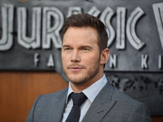 "(FILES) In this file photo taken on June 12, 2018 US actor Chris Pratt attends the premiere of ""Jurassic World: Fallen Kingdom"" at The Walt Disney Concert Hall in Los Angeles, California. Big-grossing films ""Jurassic World: Fallen Kingdom"" and ""Incredibles 2"" again dominated the North American box office this weekend, but two new entrants beat expectations to place third and fourth, according to industry estimates on July 1, 2018.  Universal's latest earth-stomping dinosaur movie took in $60 million for the three-day weekend, industry watcher Exhibitor Relations reported.  / AFP PHOTO / Robyn BeckROBYN BECK/AFP/Getty Images ORIG FILE ID: AFP_16Y82W"