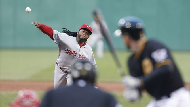 Cincinnati Reds starting pitcher Johnny Cueto (47) delivers a pitch to Pittsburgh Pirates first baseman Ike Davis (15) during the second inning.