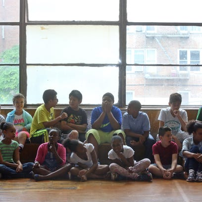 Students in the gym/cafeteria at the Museum School