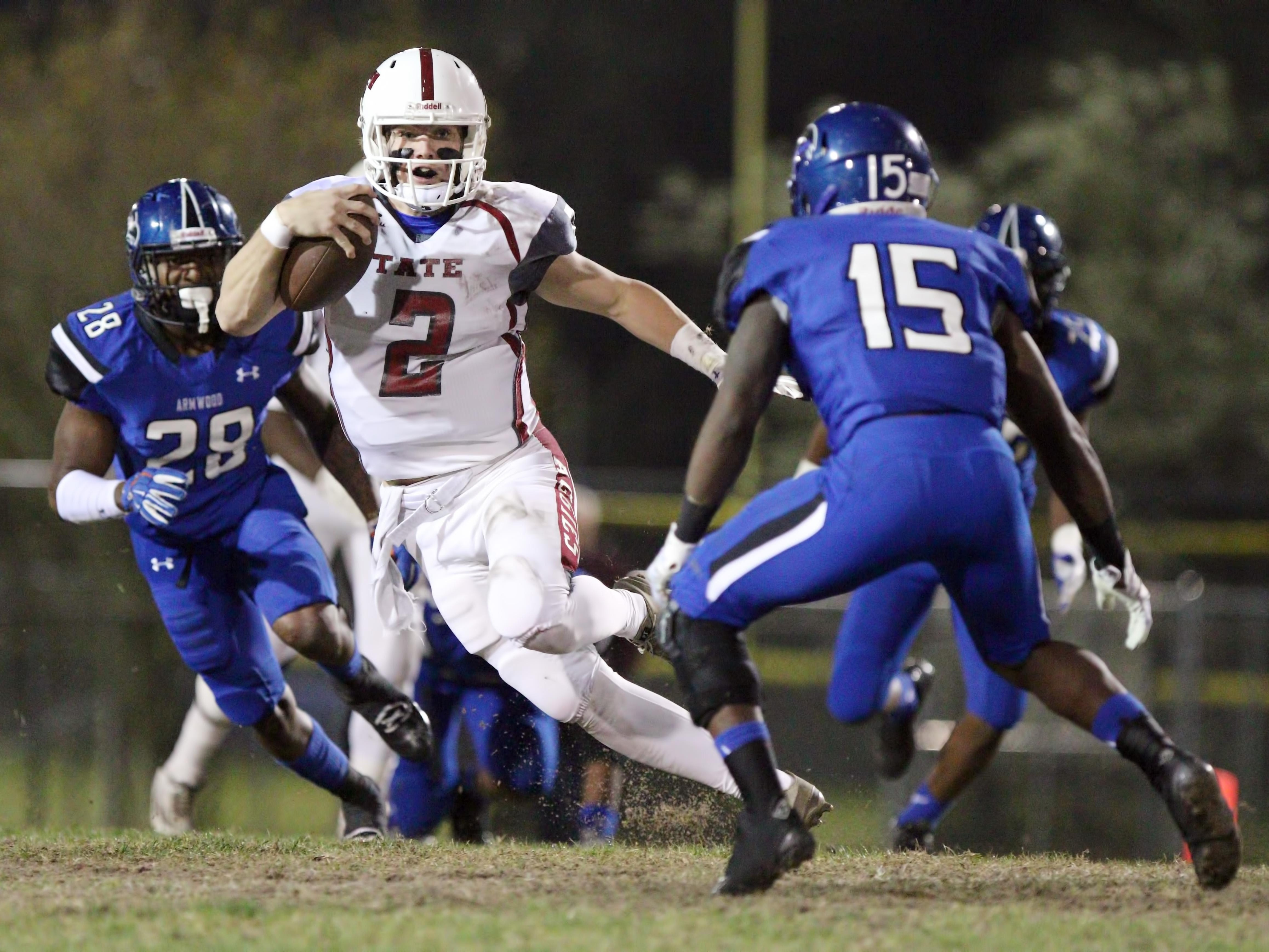 Tate quarterback Sawyer Smith scrambles for yardage against during the first half of action against Armwood in Friday's Class 6A state semigfinal at Lyle Flagg Field. The Aggies fell to the Hawks 53-19.