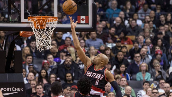 Portland Trail Blazers' Gerald Henderson (9) scores on the Toronto Raptors during the first half of an NBA basketball game in Toronto on Friday, March 4, 2016.