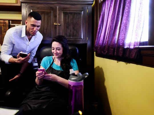 """Teddy Cravens talks about voting in the Men's Health """"Ultimate Guy"""" search with owner Rebecca Amernick at Iridescence Salon and Spa. People can vote once a day per device until the contest ends in June."""