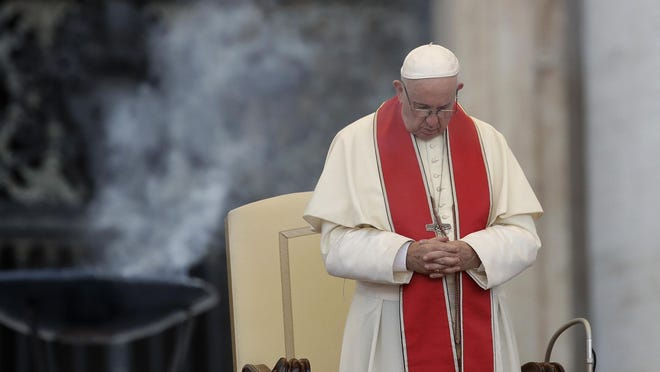 """FILE - In this file photo dated Tuesday, July 31, 2018, Pope Francis prays during an audience in St. Peter's square at the Vatican. The Vatican said Thursday Aug. 2, 2018, that Pope Francis has changed church teaching about the death penalty, saying it can never be sanctioned because it """"attacks"""" the inherent dignity of all humans. (AP Photo/Alessandra Tarantino, FILE)"""
