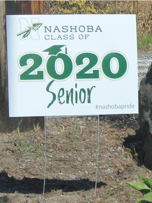 A parents' group made sure evern Nashoba graduating senior had a yard sign congratulatin ghtem on their achievement.