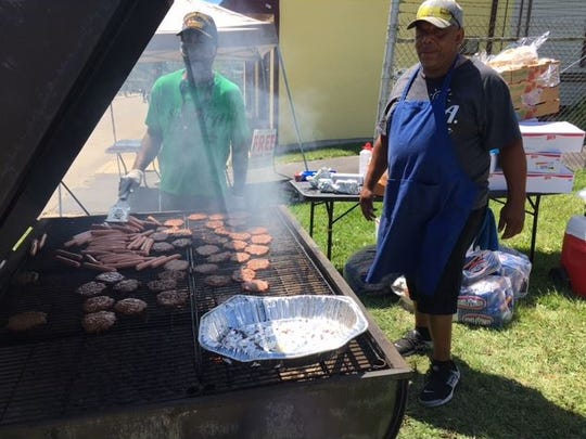 Volunteers grilled hot dogs and hamburgers for those who came to the Unity in the Community Block Party on Bowman Street. The hot dogs and burgers and other treats were free,