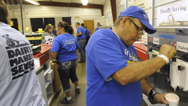 Jay Kightlinger pours a strawberry shake during the South Dakota State Fair in Huron on Thursday.