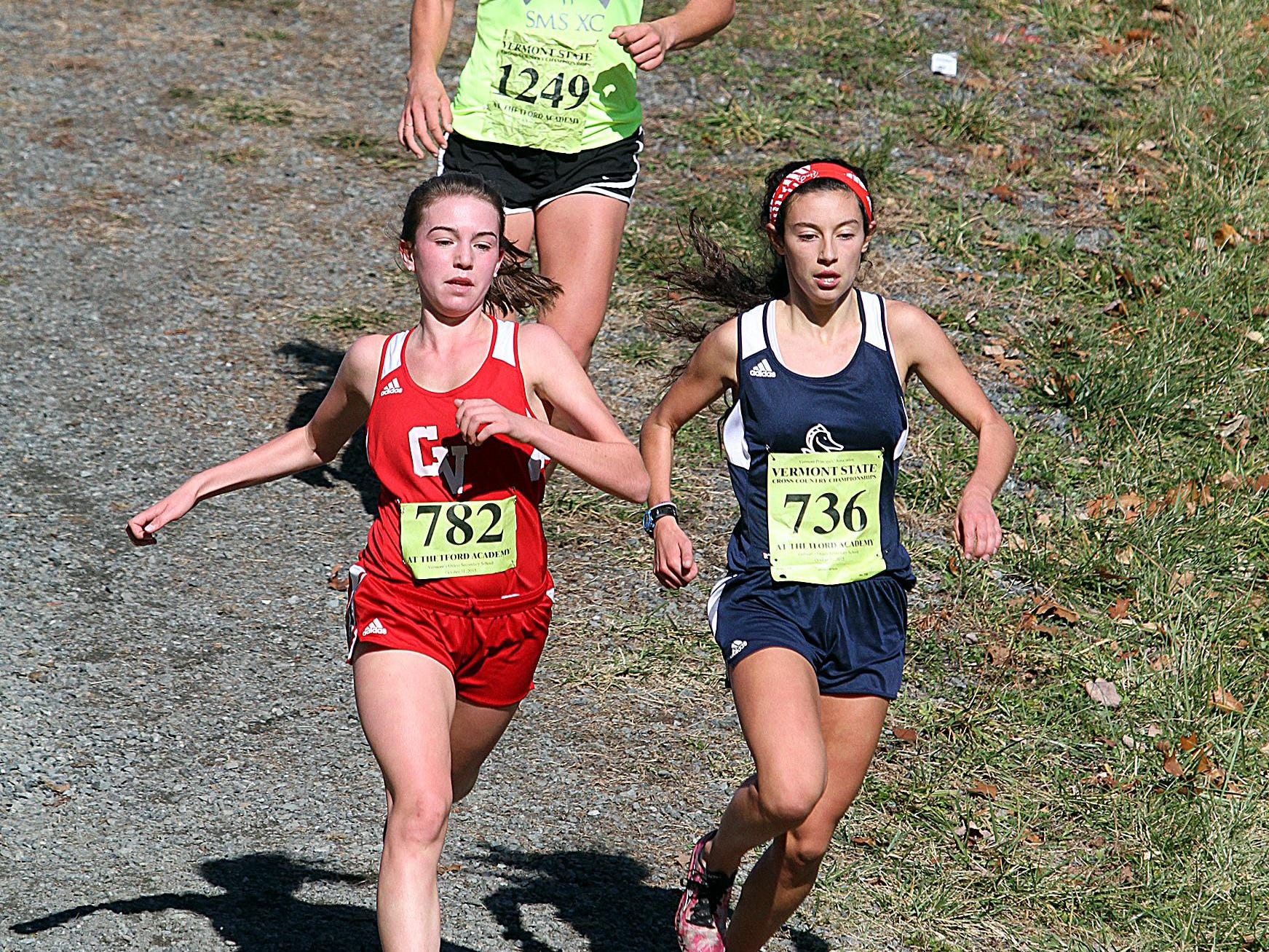 CVU's Sophia Gorman, left, Burlington's Sophie Watterson, right, and Stratton's Katharine Ogden, center, compete in the Division I cross country state championship meet at Thetford Academy on Saturday.
