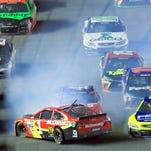NASCAR Spring Cup Series drivers Jamie McMurray (1), Paul Menard (27) and Kurt Busch (41) wreck during the Sprint Unlimited Saturday at Daytona International Speedway.
