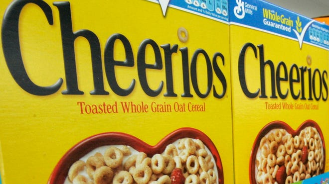 Boxes of General Mills Cheerios breakfast cereal are displayed at a Little Rock grocery store.