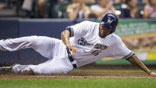 Milwaukee Brewers' Domingo Santana slides home on a Hernan Perez triple against the Pittsburgh Pirates during the sixth inning Thursday in Milwaukee.