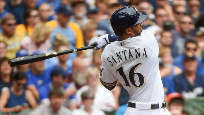 Domingo Santana delivers the big blow in the Brewers' eight-run fourth inning with a three-run double against the Marlins on Sunday at Miller Park.