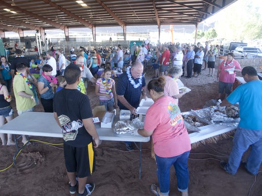 Area residents line up for food at the Washington County Fair Luau Thursday, August 7, 2014.