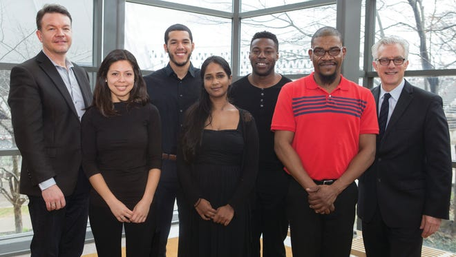 Award winners of a a cooperative program between CCM and the Cincinnati Symphony Orchestra. Left to right, CSO concertmaster Timothy Lees, cellist Diana Flores, violist Emilio Carlo, violinist Vijeta Sathyaraj, cellist Blake-Anthony Johnson , double bassist Maurice Todd and CCM dean Peter Landgren.