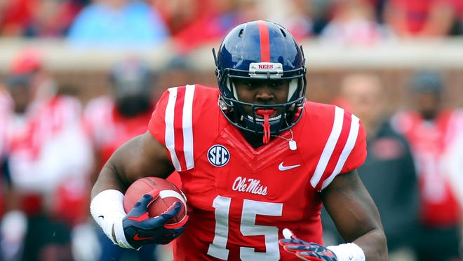 Offensive tackle Jeremy Liggins runs with the ball while playing tight end in 2014 for Ole Miss. He's part of a close competition to be the starting left tackle this fall.
