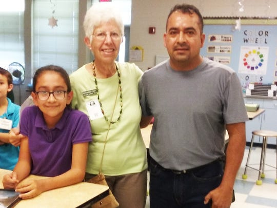 Marianne Foley, the Garden Club's scholarship chairperson, presented the campership to Camp Wekiva to Jeri Lerma at the April 4 after-school meeting of Junior Gardeners, a Calusa Garden Club-sponsored activity. Above: Foley, Jeri Lerma and Jeri's father.
