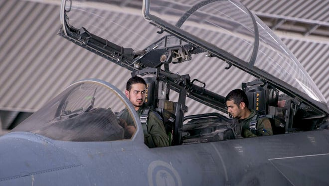 Saudi pilots sit in the cockpit of a fighter jet as part of U.S.-led coalition airstrikes on Islamic State militants and other targets in Syria, in Saudi Arabia, on Sept. 24, 2014.