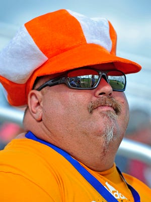 Lawrence County fan Richard Brewer sits int he stand watching the Babe Ruth 13-15 World Series championship in Lawrenceburg, Tenn., Thursday, Aug. 20, 2015.