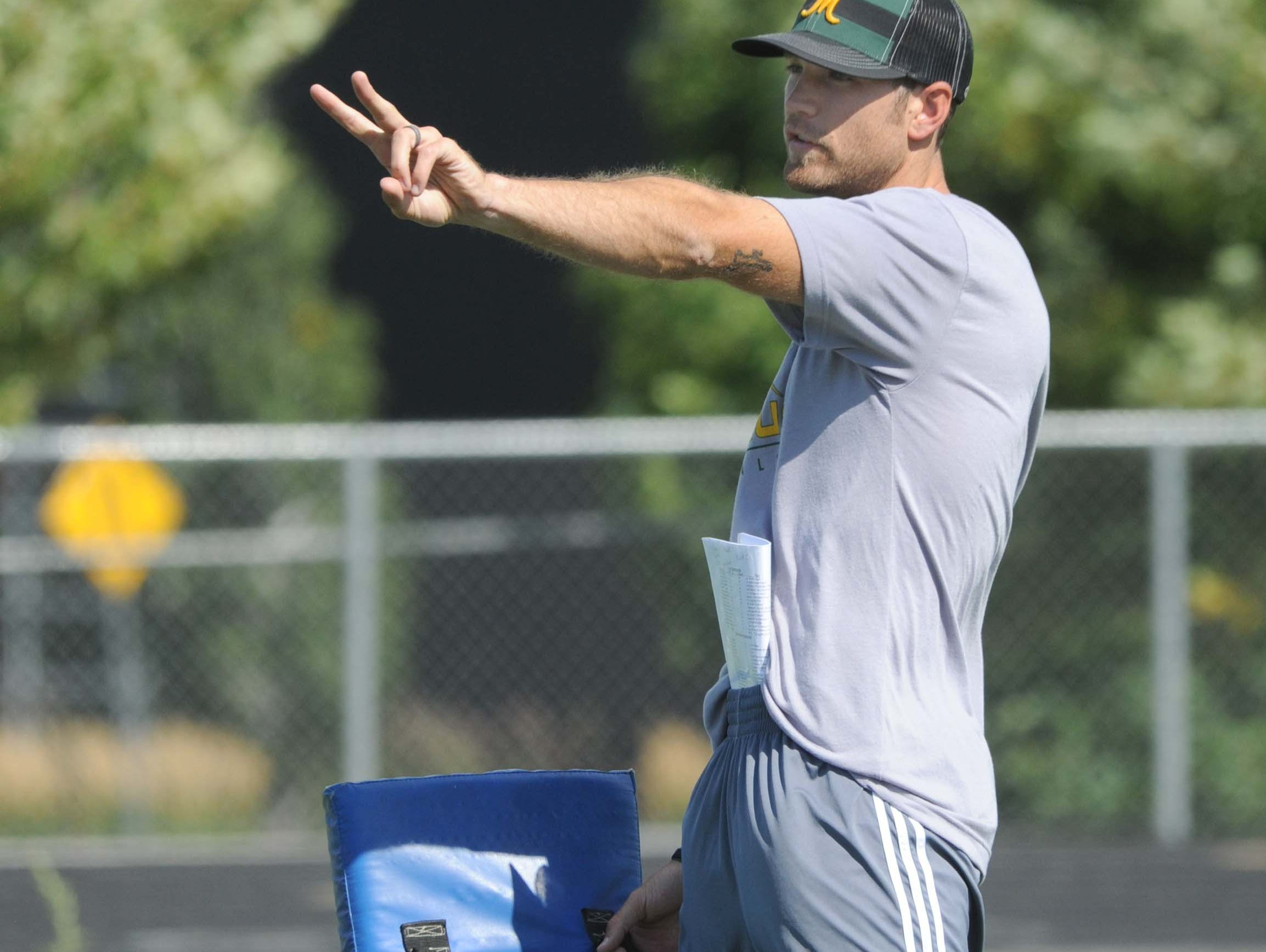 Bishop Manogue football coach Thomas Peregrin announced he will resign