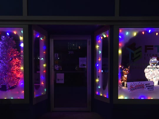 FTS Technology, 311 Steele St., Algoma, dressed up its front windows to tie for first place in the Business Retro category.