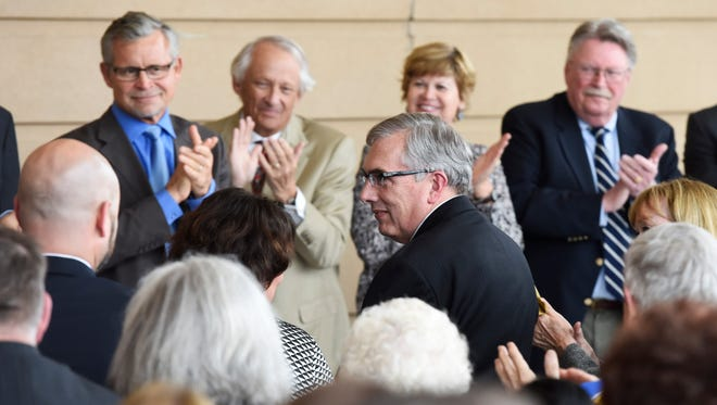 Barry Dunn stands to be recognized after being announced as the next president of South Dakota State Monday at a meeting of the South Dakota Board of Regents in Brookings, April 25, 2016.