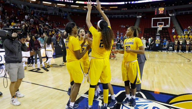 California players celebrate at center court after they upset Arizona State 75-64.