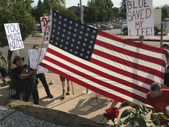 Donald Mobley's friends waved a U.S. flag in a show of support for him.